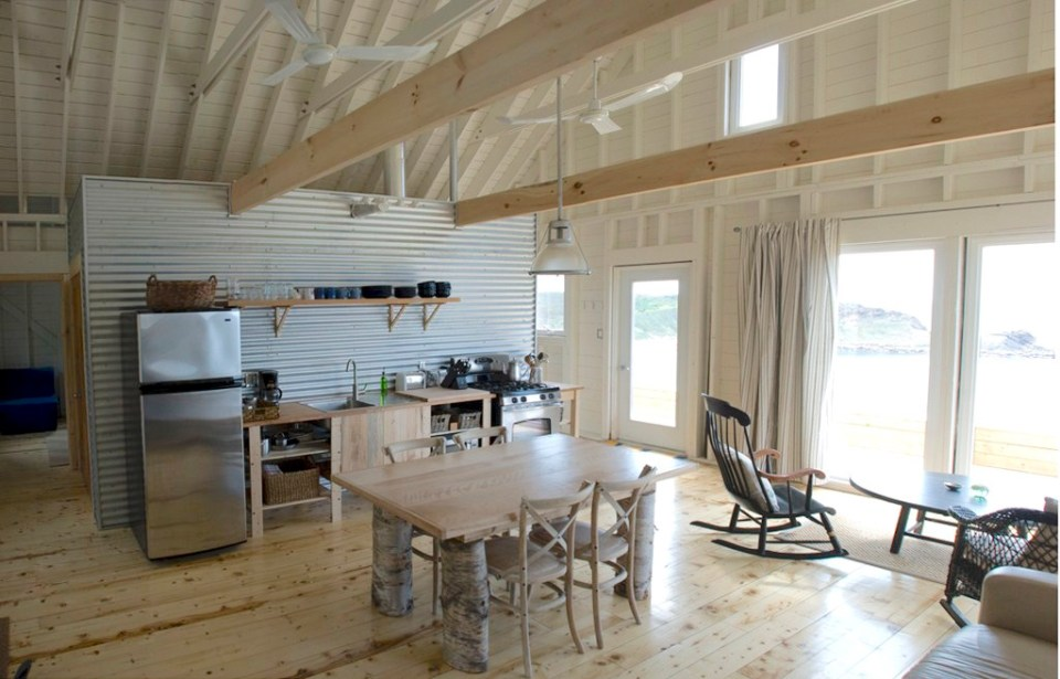 An owner-built cottage on Cape Breton Island with traditional and contemporary details. It has two bedrooms in 768 sq ft.   www.facebook.com/SmallHouseBliss