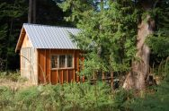 Tiny rustic cabin, exterior with fiberglass wall