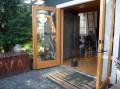 A single-car garage converted into a tiny house with a sleeping loft.   www.facebook.com/SmallHouseBliss