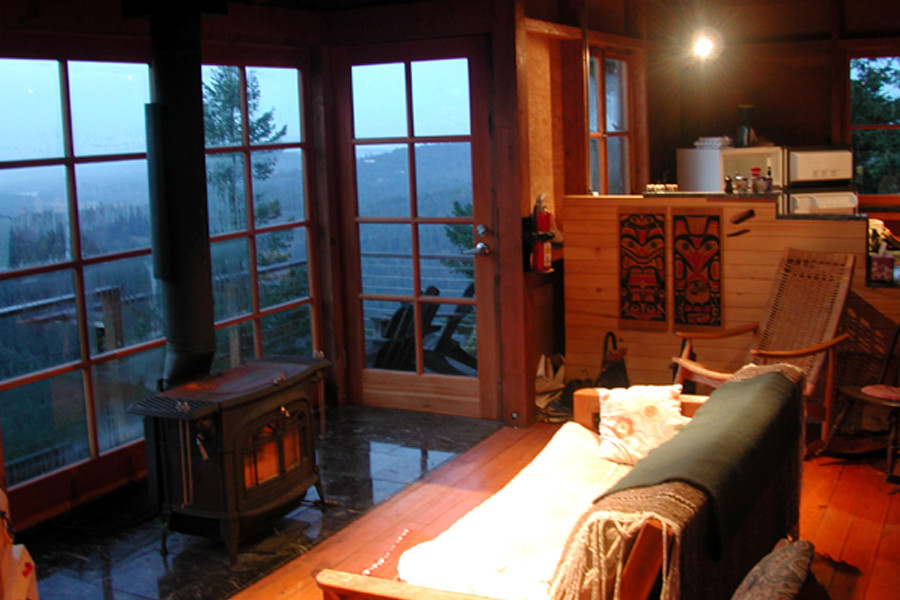 Reminiscent of forest fire lookout towers, this 672 sq ft cabin has two separate sleeping lofts. | www.facebook.com/SmallHouseBliss