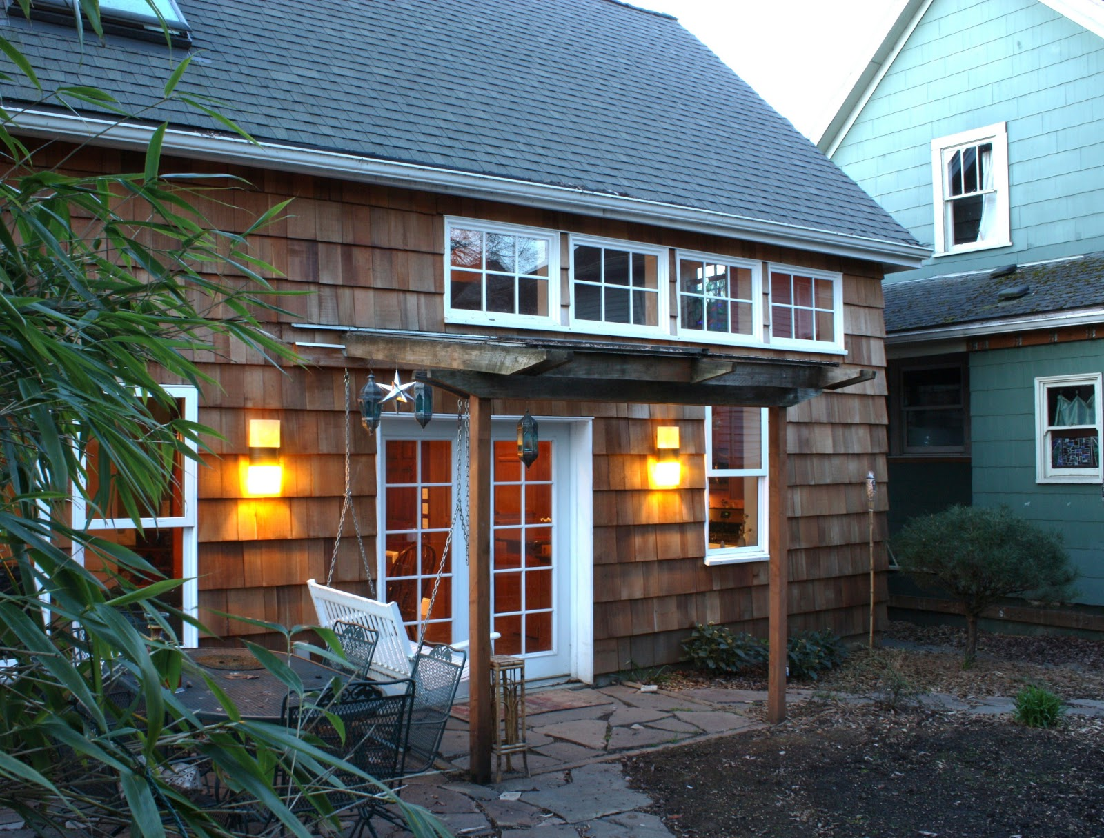 This Shingled Backyard Cottage Has 1 Bedroom And A Small Office In 799 Sq  Ft.