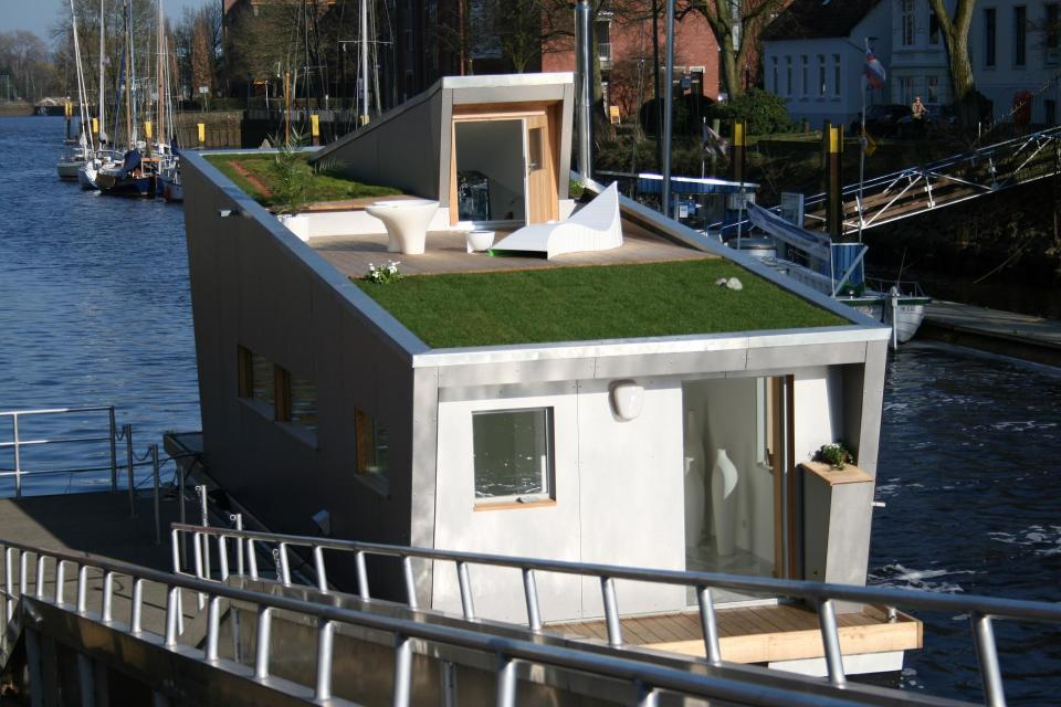 The Silberfisch, a modern floating home with 431 sq ft on the main deck plus a sleeping loft. | www.facebook.com/SmallHouseBliss