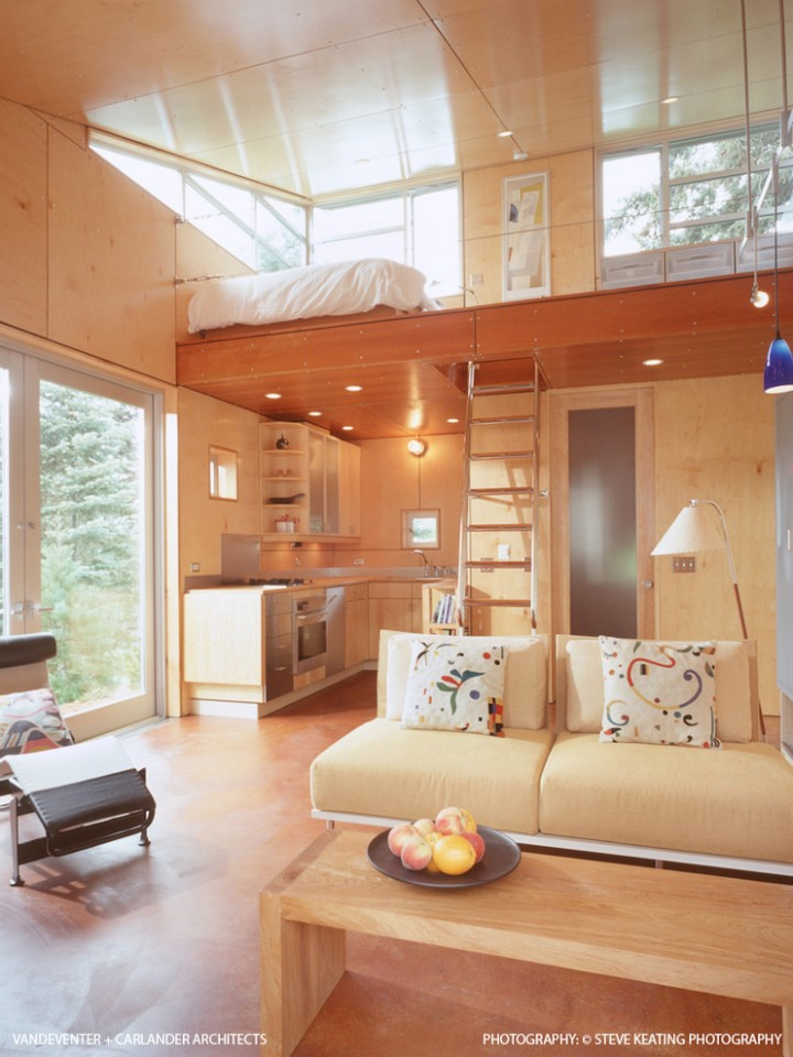 The C3 Cabin has nautical-inspired finishes and a compact 16' x 22' footprint with a lofted bedroom. | www.facebook.com/SmallHouseBliss