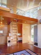 The C3 Cabin has nautical-inspired finishes and a compact 16' x 22' footprint with a lofted bedroom.   www.facebook.com/SmallHouseBliss