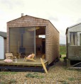 Designer Nina Tolstrup's tiny beach hut comfortably accommodates her family of four in its 388 sq ft.   www.facebook.com/SmallHouseBliss