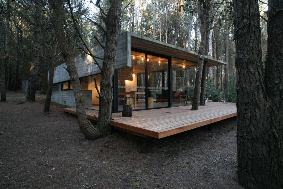 A low-maintenance concrete and glass house in Argentina with 2 bedrooms in 721 sq ft. | www.facebook.com/SmallHouseBliss