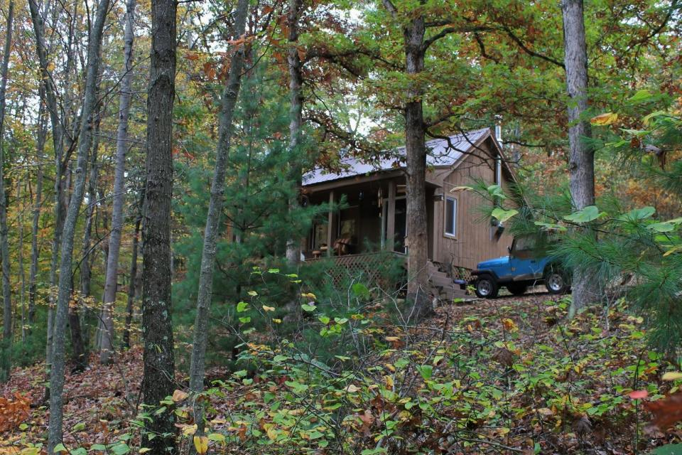 "Dave Fosson's ""ManCamp"" cabin in the woods is 16' by 24' and has a sleeping loft. 