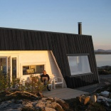 An irregular horseshoe-shaped floor plan provides shelter from the wind for this family cabin in Norway. It has 3 bedrooms in 829 sq ft. | www.facebook.com/SmallHouseBliss