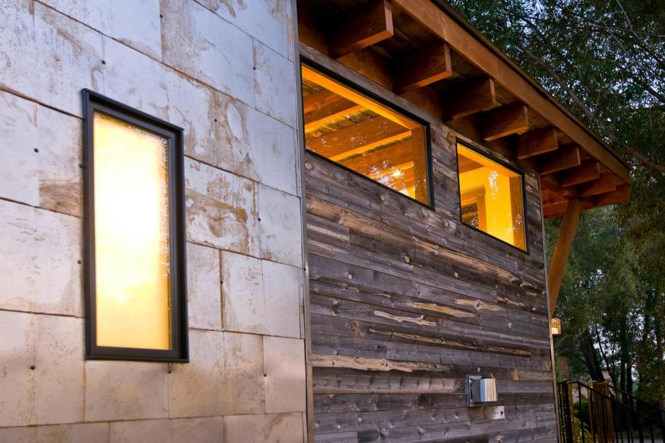 "The WheelHaus Wedge, a small cabin on wheels. The ""rustic modern"" cabin has one bedroom in 400 sq ft. 