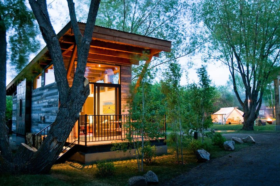 """The WheelHaus Wedge, a small cabin on wheels. The """"rustic modern"""" cabin has one bedroom in 400 sq ft. 