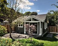 A small laneway house designed to blend with its traditional neighbors. The 400 sq ft cottage is a studio design with a sleeping loft.   www.facebook.com/SmallHouseBliss