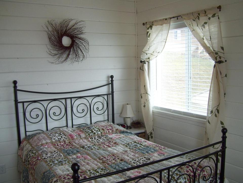 AnnaMarie's Cottage, a small owner-built home with custom hand-crafted features. It has one bedroom in 716 sq ft. | www.facebook.com/SmallHouseBliss