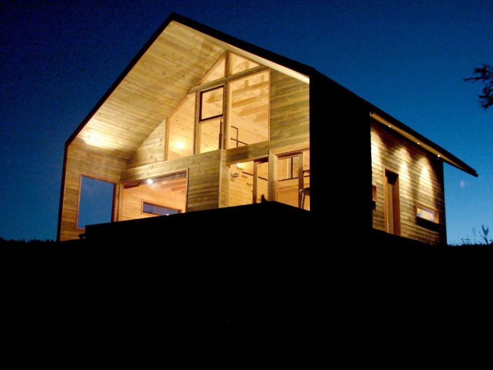 Cabaña Bascuñan, a family vacation house with a surprising and playful design. It has two bedrooms and a very large loft in 1,184 sq ft.   www.facebook.com/SmallHouseBliss