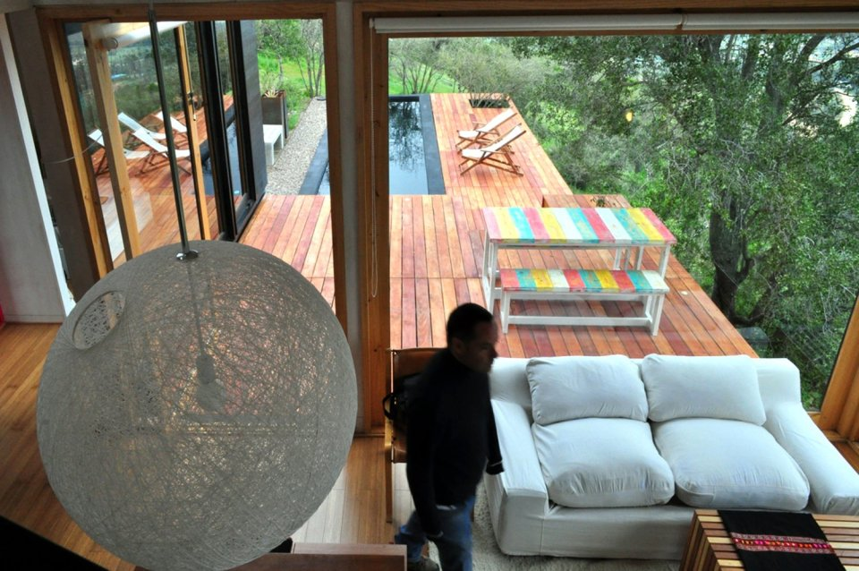 Refugio Pangal, a simple modern cabin in Chile with one bedroom and a loft in 646 sq ft. | www.facebook.com/SmallHouseBliss