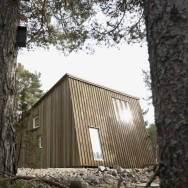 This modern resort cabin in Sweden has a design inspired by camping tents. It has two bedrooms and a loft in 969 sq ft. | www.facebook.com/SmallHouseBliss
