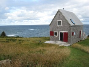 Sea and Sky Cottage on Cape Breton updates the traditional Maritime gable-roofed, shingled house with an open interior. It is 860 sq ft with a lofted bedroom. | www.facebook.com/SmallHouseBliss
