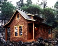 A small cabin in the woods on Orcas Island by David Vandervort