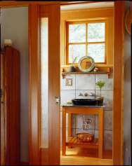 This small cabin in the woods on Orcas Island has a 350 sq ft ground floor plus a sleeping loft.   www.facebook.com/SmallHouseBliss