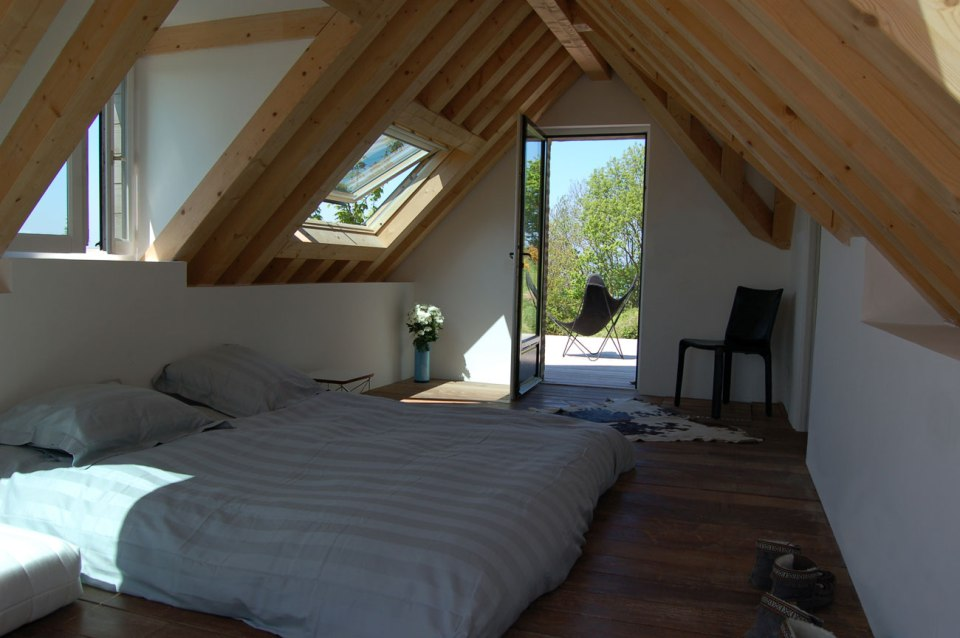 The remnants of a tiny stone cottage were restored and expanded with a small addition. It now has 334 sq ft downstairs and one bedroom up.   www.facebook.com/SmallHouseBliss