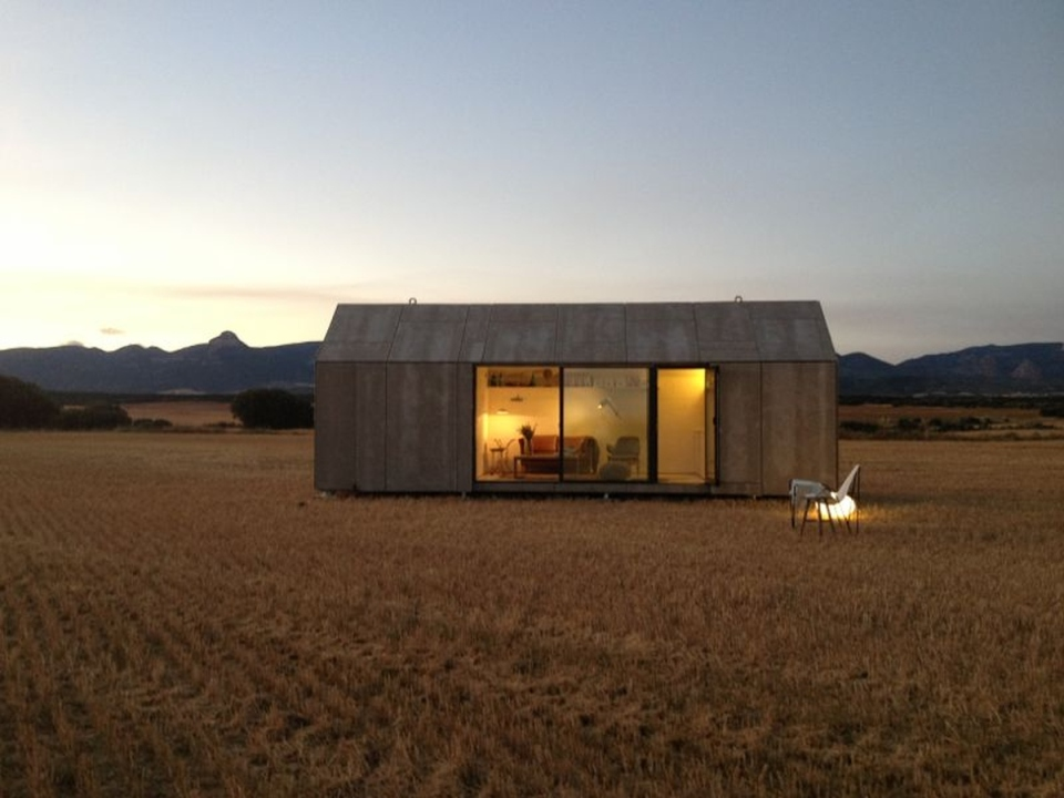 The ÁPH80 Transportable House, a tiny prefab with a minimalist design aesthetic, has one bedroom in 291 sq ft. | www.facebook.com/SmallHouseBliss