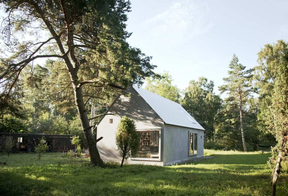 This small summer house in Sweden was inspired by local barns. It has an open interior with two sleeping spaces in 689 sq ft. Straightforward design and simple materials kept the cost down. | www.facebook.com/SmallHouseBliss