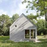 This small summer house in Sweden was inspired by local barns. It has an open interior with two sleeping spaces in 689 sq ft. Straightforward design and simple materials kept the cost down.   www.facebook.com/SmallHouseBliss