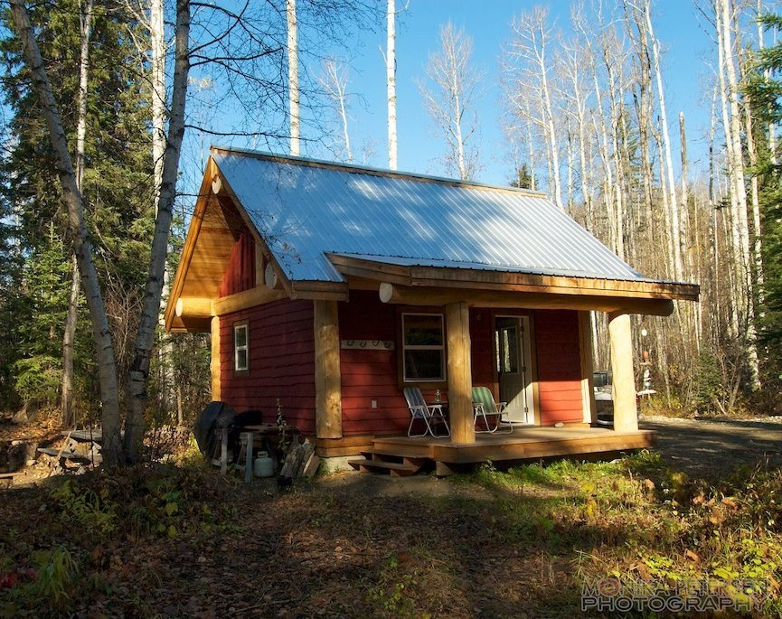 A Small Post And Beam Cabin In The Woods Of British Columbia. It Has A