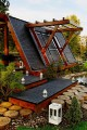 The Soleta zeroEnergy One, an eco-friendly modular house with an unusual gambrel roof design. It has 614 sq ft with a lofted bedroom.   www.facebook.com/SmallHouseBliss
