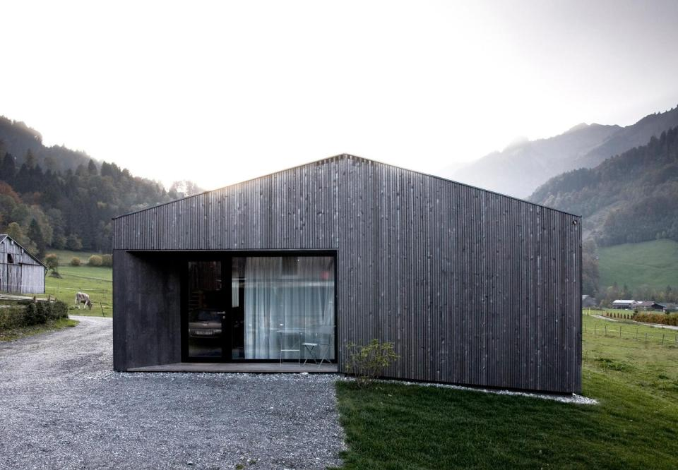 """Located in the Austrian Alps, """"House for Gudrun"""" is a small and modern version of the traditional Alpine chalet. It has two bedrooms in 969 sq ft. 