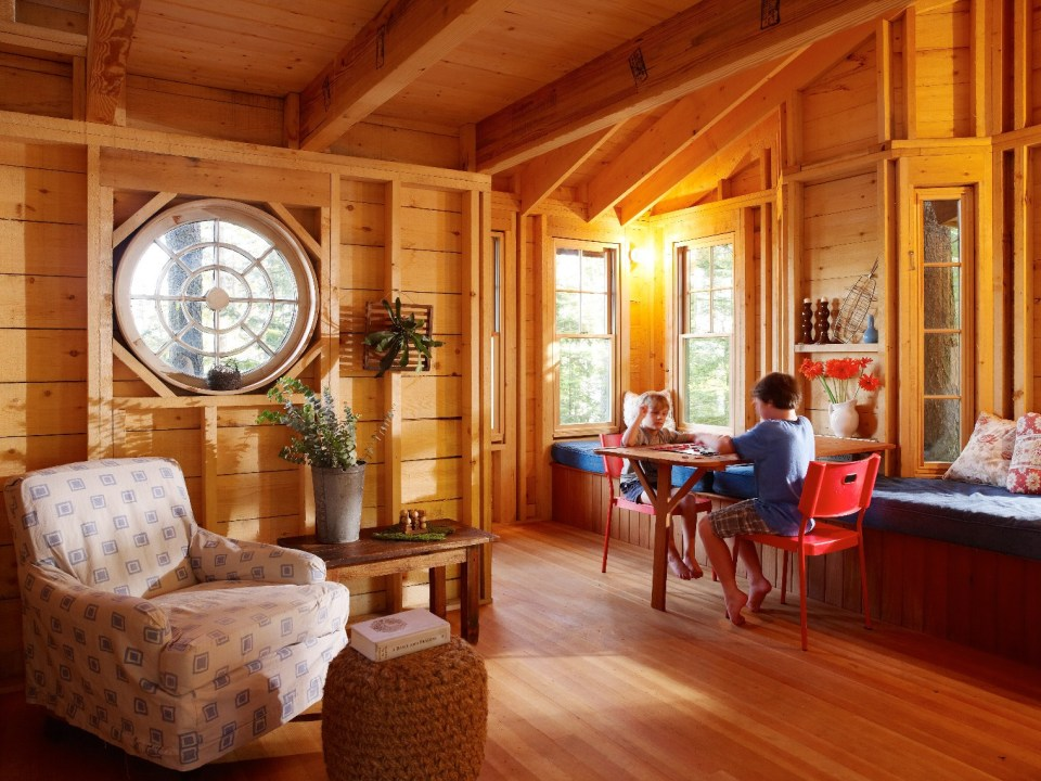 "This 350 sq ft ""treehouse"" is used as a playhouse and family hangout space. 
