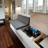 Minim House, a 242 sq ft tiny house with multi-functional furniture and a pull-out bed instead of the usual sleeping loft. | www.facebook.com/SmallHouseBliss
