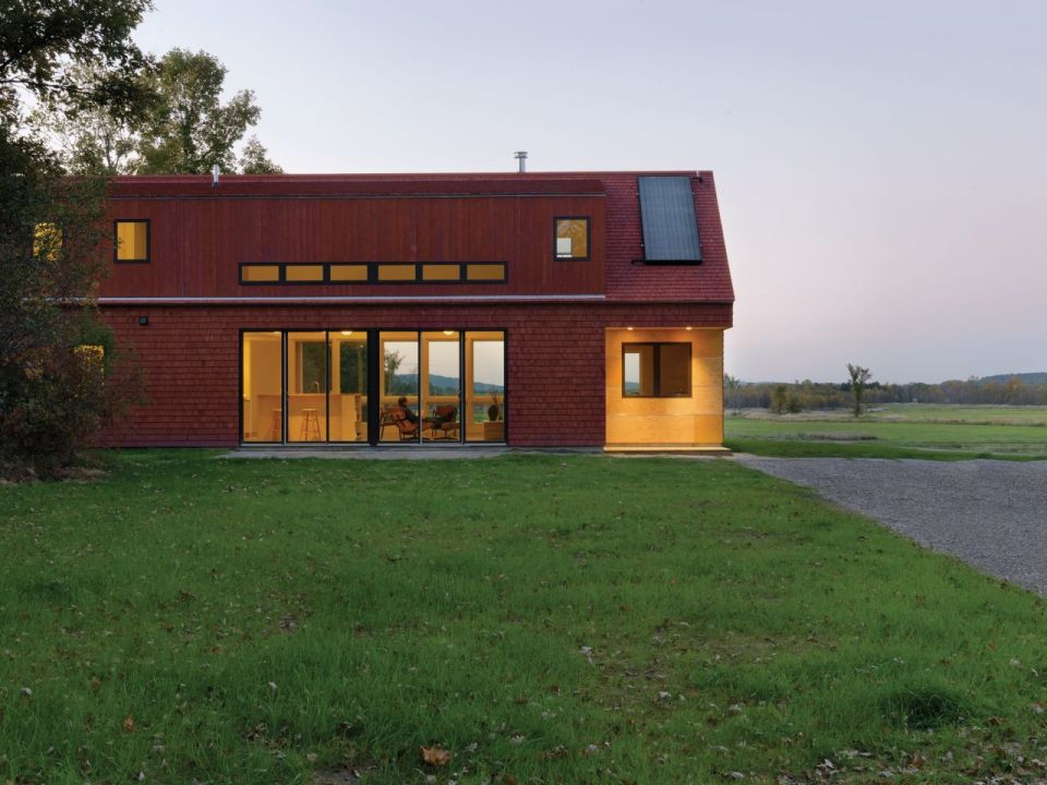 This modern farmhouse in Vermont was inspired by the area's barns and covered bridges. It has three bedrooms and a loft in 1,500 sq ft. | www.facebook.com/SmallHouseBliss