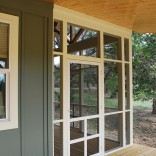 This Texas Hill Country cottage by Kanga Room Systems is a 480 sq ft studio with loft bedroom plus 432 sq ft of porches | www.facebook.com/SmallHouseBliss