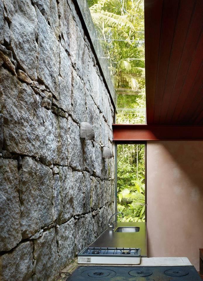 Casa Rio Bonito, a modern cabin in the Brazilian rainforest, has 1 bedroom in 753 sq ft   www.facebook.com/SmallHouseBliss