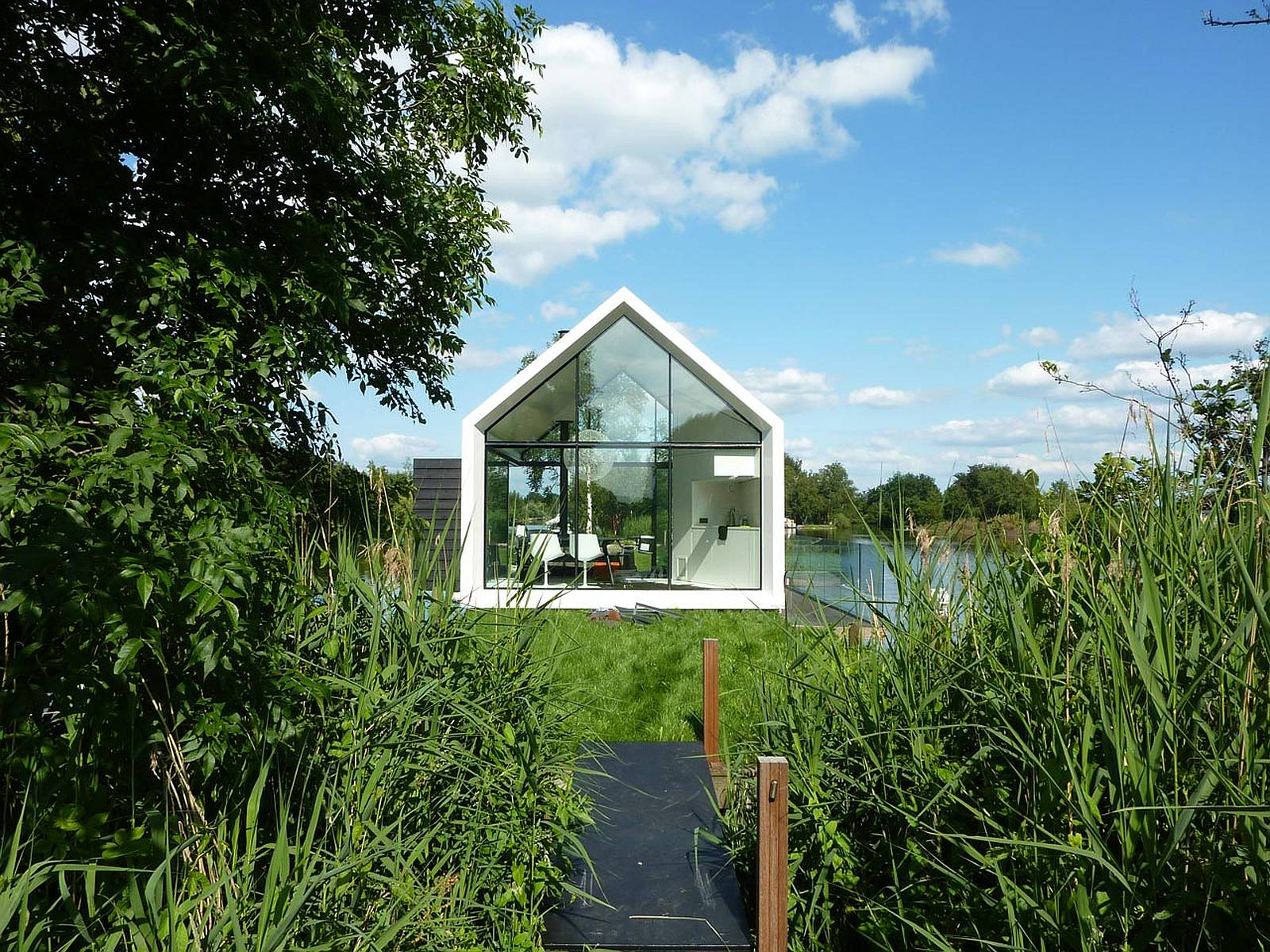 Island house 2by4 architects small house bliss for Tiny house architects