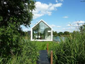 This tiny 226 sq ft lake house opens to the outdoors with a folding wall. 2by4-architects has also designed a prefab version.   www.facebook.com/SmallHouseBliss