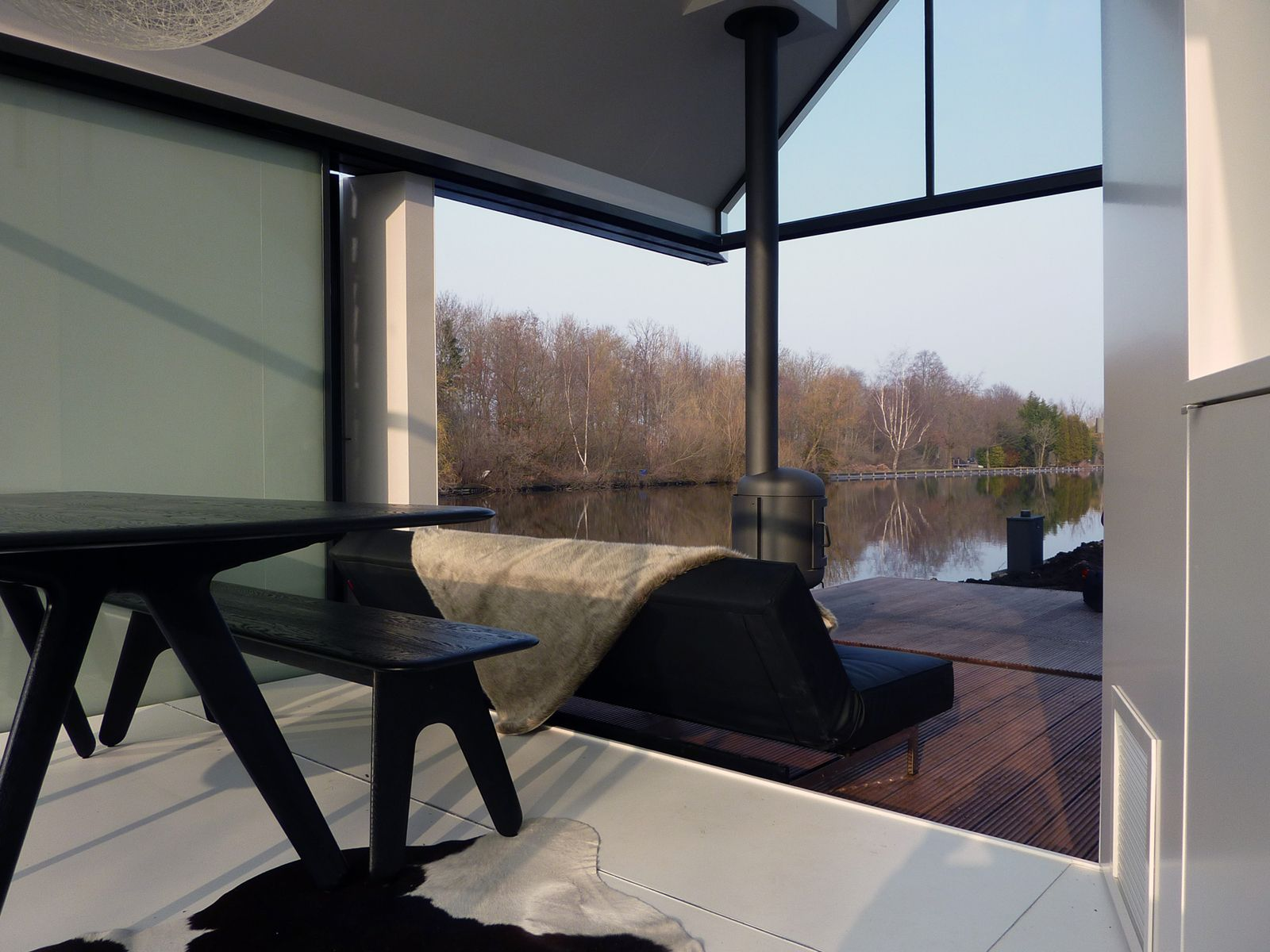 this tiny 226 sq ft lake house opens to the outdoors with a folding wall
