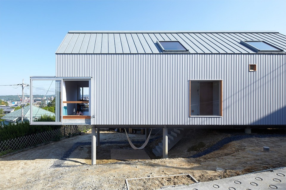 This small house offers a harmonious living space for a family displaced by the 2011 earthquake in Japan. It has 2 bedrooms and loft space in 1,281 sq ft. | www.facebook.com/SmallHouseBliss