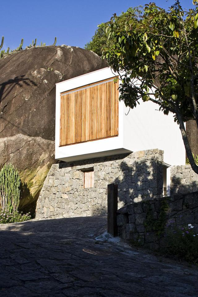 A small house in Brazil with traditional stone walls topped by a modern concrete box. It has 1 bedroom in 387 sq ft.   www.facebook.com/SmallHouseBliss