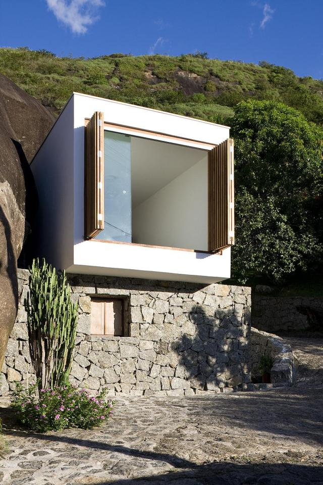 A small house in Brazil with traditional stone walls topped by a modern concrete box. It has 1 bedroom in 387 sq ft. | www.facebook.com/SmallHouseBliss
