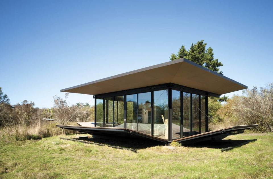 This modern cabin by Olson Kundig Architects is open to nature with glass walls on three sides. It has 500 sq ft of studio living space.   www.facebook.com/SmallHouseBliss