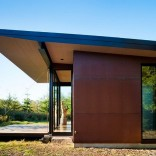 This modern cabin by Olson Kundig Architects is open to nature with glass walls on three sides. It has 500 sq ft of studio living space. | www.facebook.com/SmallHouseBliss