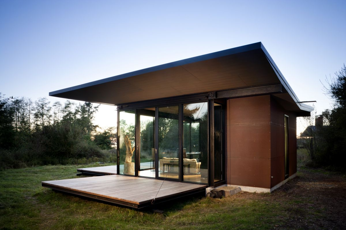 This Modern Cabin By Olson Kundig Architects Is Open To Nature With Glass Walls On Three