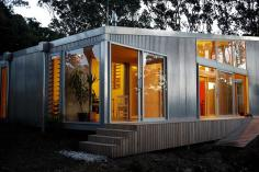 """This """"bach"""" (a simple, inexpensive vacation house) for a New Zealand family has 4 bedrooms in 1,507 sq ft. Designed by architects Bonnifait + Giesen, Atelierworkshop. 