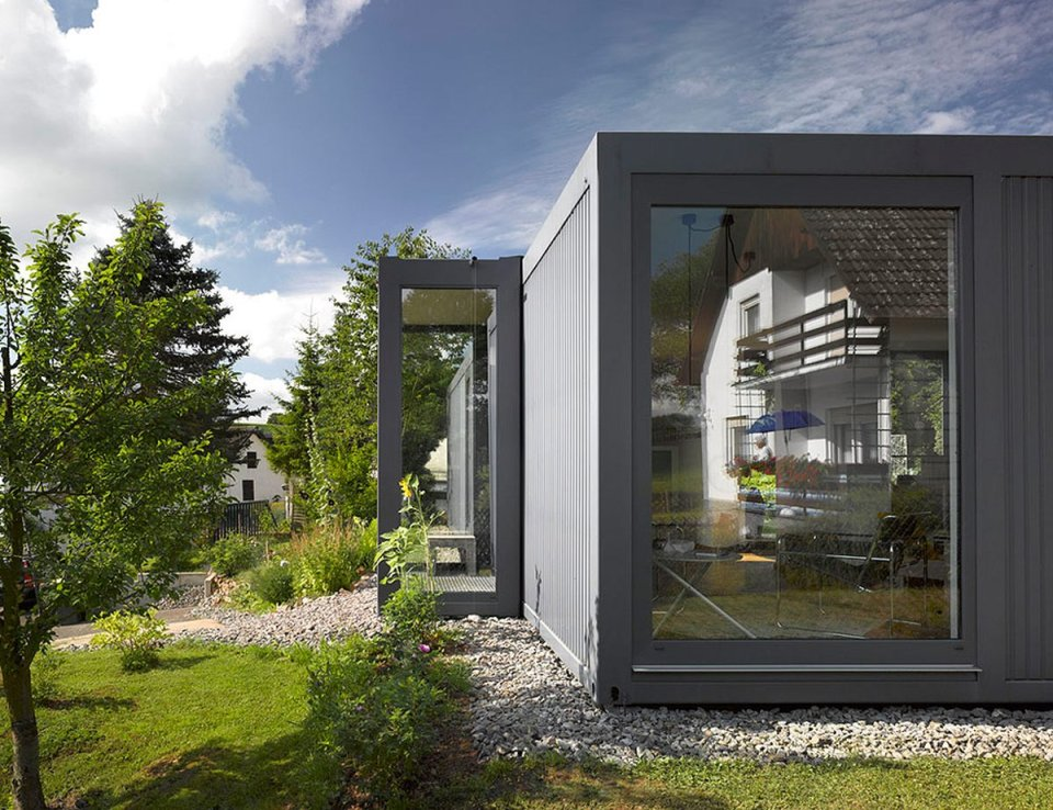 ContainerLove, a small house built from modules designed to resemble shipping containers. It has 2 bedrooms and room for a 3rd in about 969 sq ft. | www.facebook.com/SmallHouseBliss