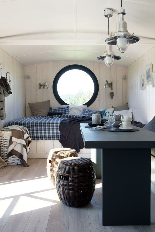 A modern version of the traditional wagon dwelling. It has a full kitchen, 3-piece bath and built-in bed in 258 sq ft. | www.facebook.com/SmallHouseBliss
