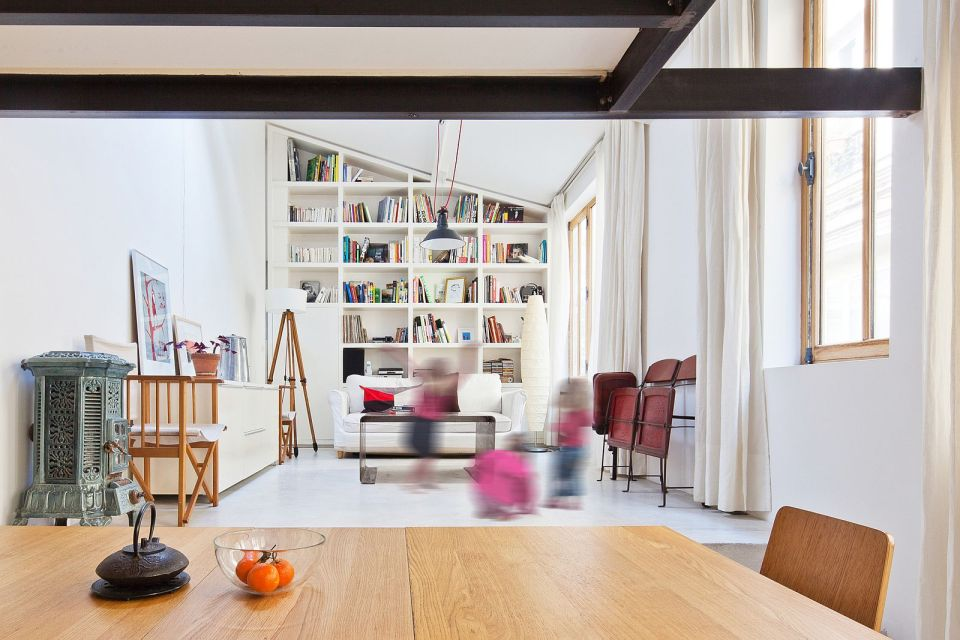 A dingy workshop in Paris was transformed into this bright and airy home with a glass-enclosed loft. | www.facebook.com/SmallHouseBliss