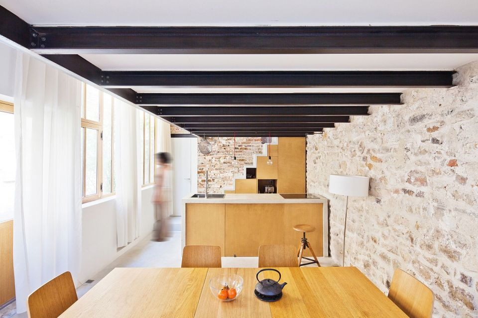 A dingy workshop in Paris was transformed into this bright and airy home with a glass-enclosed loft.   www.facebook.com/SmallHouseBliss