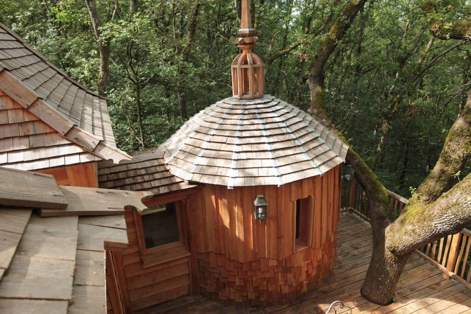 Cabane Hautefort at Châteaux Dans Les Arbres is a luxury treehouse with 3 bedrooms and a full kitchen and bath in 603 sq ft. | www.facebook.com/SmallHouseBliss