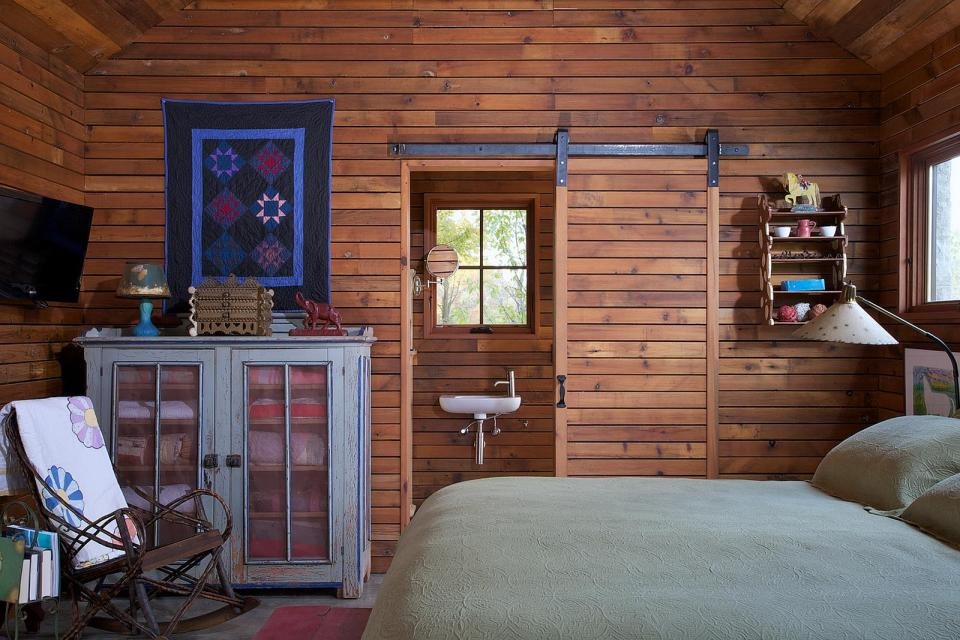 A small stone cabin with compact kitchen and bath in 350 sq ft. | www.facebook.com/SmallHouseBliss